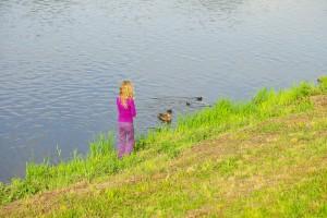 girl looking at ducks